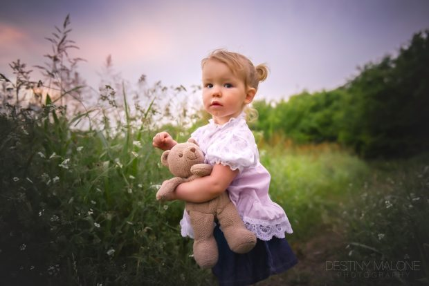 toddler with teddy bear